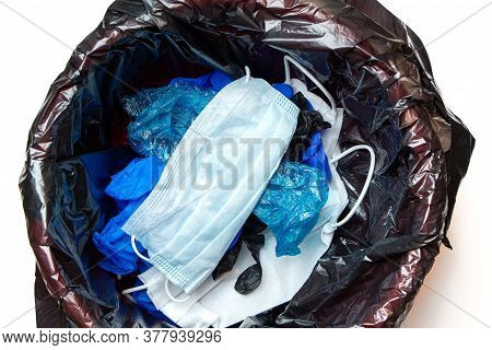 Thrown Out, Discarded Medical Gloves And Protective Masks In The Trash Bin After Quarantine