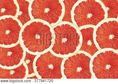 Bright Red-orange Background Of Round Grapefruit Lobules. Drawing For The Surface Of Wallpaper, Pape