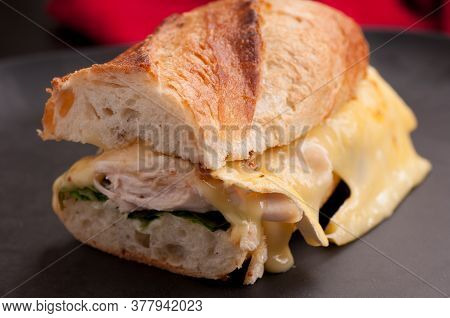 Brie Melted On Chicken On A Baguette Bread Roll