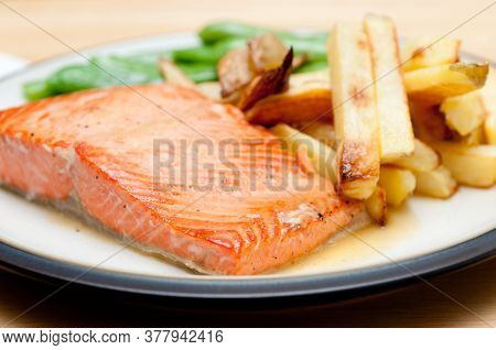 Maple Glazed Salmon Fillet With French Fries And Snap Peas, Full Of Cancer Fighting Anti Oxidants
