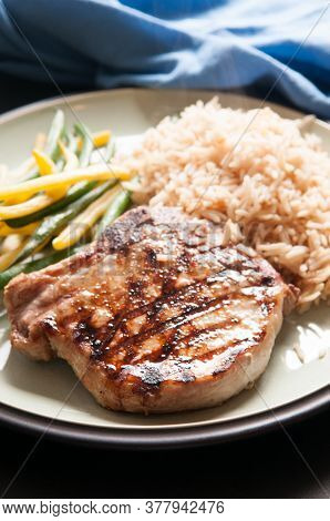 Grilled Pork Chop With Rice And Steam Vegetables