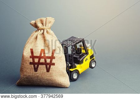 Yellow Forklift Unable To Lift A South Korean Won Money Bag. Interest Rate. Stimulating Economy. Hel