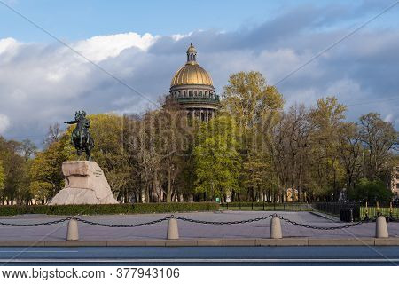 The Bronze Horseman Is An Equestrian Statue Of Peter The Great In The Senate Square.  Gold Dome Of S