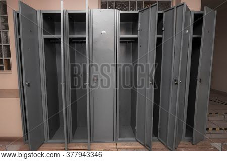 Locker Room With Gray Lockers For The Employees At The Work Place