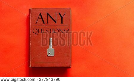 Red Book With Text Any Questions And A Key On A Red Background