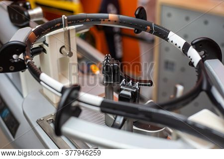 Process Of Stringing A Tennis Racket In A Tennis Shop, Sport And Leisure Concept, Maintenance And Tu