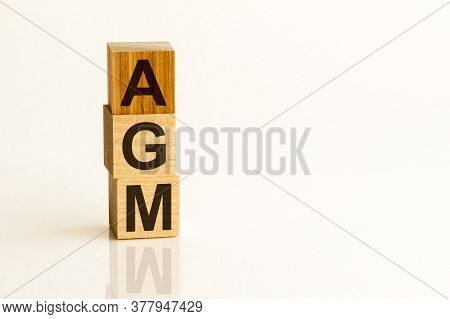 Agm Annual General Meeting Acronym On Wooden Cubes On White Backround. Business Concept.