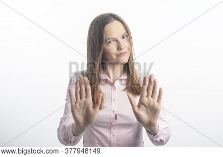 Young Woman Gesturing Stop Or Saying No With A Smile, With Flirt And Coquetry, Extending Her Hands P
