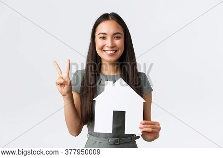 Insurance, Loan, Real Estate And Family Concept. Smiling Attractive Asian Woman Selling Or Buying Ap