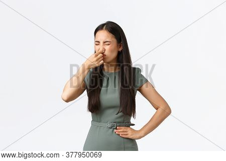 Small Business Owners, Women Entrepreneurs Concept. Disgusted Asian Female In Elegant Dress Shut Her