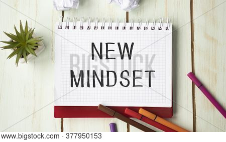 Top View Image Of Table With Open Notebook And The Text New Mindset New Results. Success And Persona