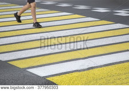 Pedestrian Crosswalk In The City. Yellow And White Pedestrian Crosswalk.