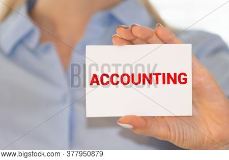 Accounting Word Inscription On A Yellow Folder With Calculator And Pen On Unfocused Foreground. Whit