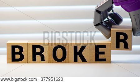 Broker Word Written On Wood Block. Broker Text On Wooden Table For Your Desing, Concept.