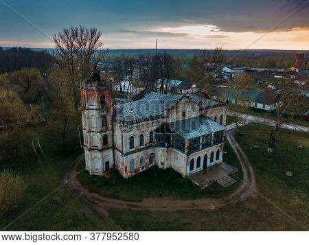 Old Abandoned Ruined Mansion In Gothic Style With Stained Glass Windows In Avchurino, Aerial View