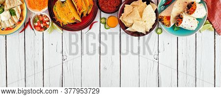 Mexican Food Top Border, Overhead View On A White Wood Banner Background. Quesadilla, Tacos, Nachos
