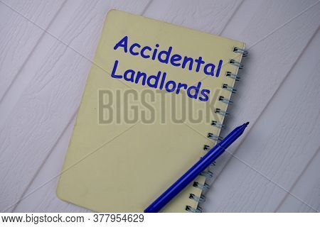 Book About Accidental Landlords Isolated On Wooden Table.