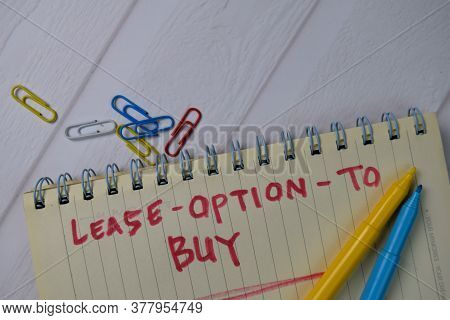 Lease - Option - To Buy Text Write On A Book Isolated Wooden Table.