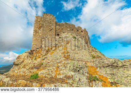 Close Up View Of Volterraio Fortress On Rock At 394 M. Volterraio Is Symbol Of Elba Island In Portof
