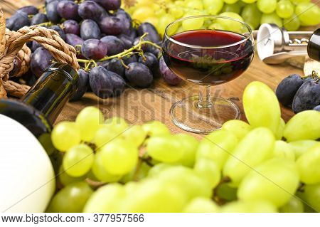 A Glass Of Red Wine And Grapes. Traditional Italian Holiday And Summer Holidays, Ferragosto Harvest