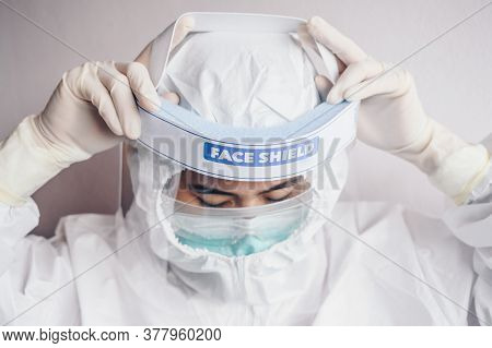 Healthcare Worker Trying To Wearing Ppe Suit For Working In Hospital During Covid-19 Pandemic. Ppe I