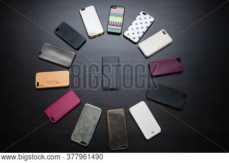 Pile Of Multicolored Plastic Back Covers For Mobile Phone On Black Background. Choice Of Smart Phone