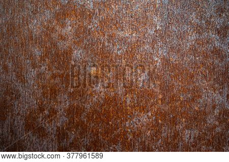 Rusty Metal Texture Background. Old Oxidized Copper Surface. Corrosion Wallpaper.