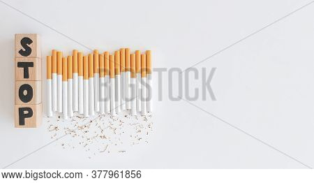 Overhead View Of Stop Text Wood Cube From Cigarette, Stop Smoking Initiative Cubic Wooded Concept Of