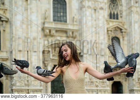 Happy Traveler Girl In Milan City. Fashion Female Tourist Standing On Piazza Duomo Square In Milan.