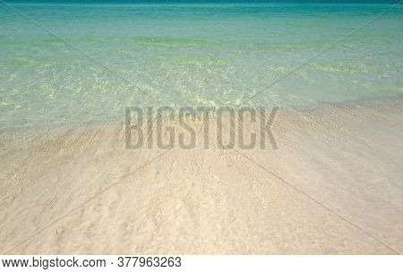 Wave Of The Sea On The Sand Beach. Sand Beach With Blue Ocean And Cloudscape Background. Sea Panoram