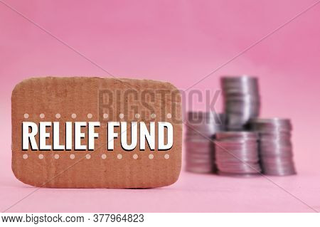 Relief Fund Note With Blurred Stack Coins Money In Background