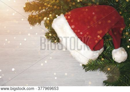 Merry Christmas And Happy New Year 2021. Christmas Tree And Santa Hat. A New Year's Background With