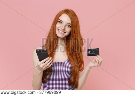 Smiling Young Redhead Woman Girl In Plaid Dress Posing Isolated On Pastel Pink Wall Background Studi