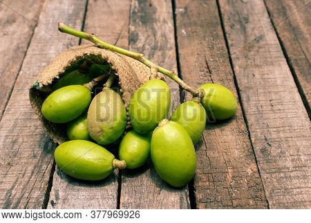 Hog Plum Or Spondias Mombin In A Jute Sack Isolated On Wooden Background