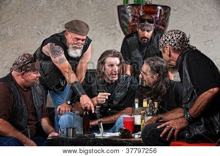 Bikers Talking At Table