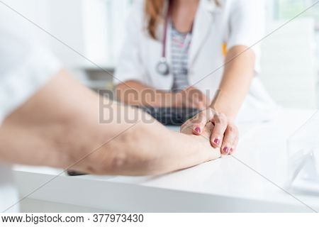 Doctor And Patient Medical Exam. Doctor Reassure Senior Woman Patient. Senior Woman At Medical Exam.