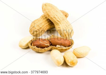 Heap Of Dried, Opened And Closed Peanut Shells With Nuts Visible Isolated On White Background