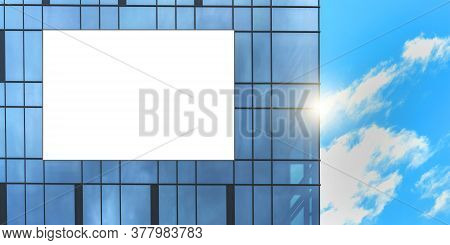 White Banner With Space For Template On Building Wall Panoramic Windows Reflecting Skyscape Against