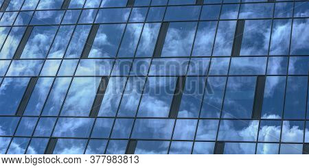 Deep Blue Sky And White Cumulus Clouds Reflecting In Highrise Building Panoramic Windows At Bright S