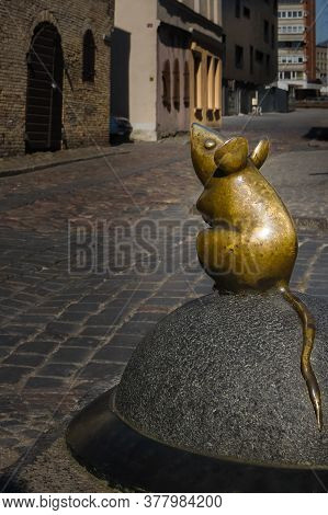 April 17, 2019, Klaipeda, Lithuania - City Attraction Of Tiny Mouse Street Statue In Old Town. City