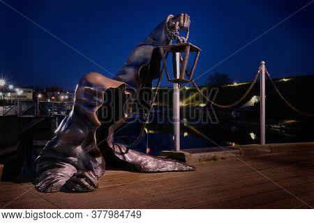 April 16, 2019, Klaipeda, Lithuania - City Attraction Metal Statue In Old Port. Legend Of Black Face