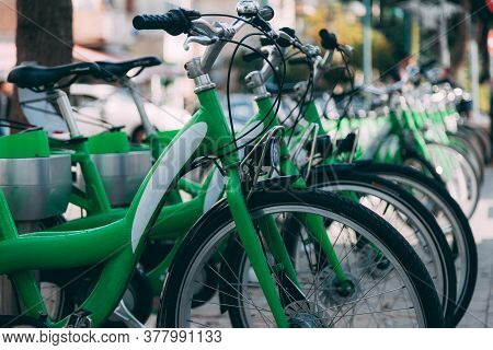 Perspective Of Green City Bikes In Israel. Bike Rental Service In The City. Group Of Bikes. Urban Tr