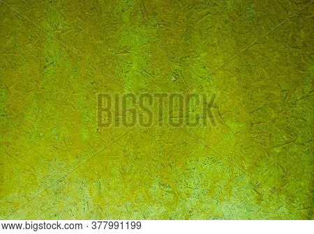 Old Green Uneven Grainy Background With Spots. Artificial Synthetic Material. Closeup