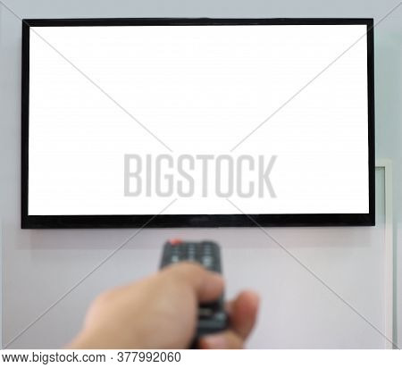 Empty Tv Screen  And The Hand Is Holding The Remote Control To Change The Channel.