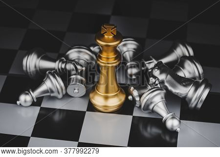 Winner. Gold King With Silver Chess Pieces On Chess Board Game Competition On Dark Background, Chess