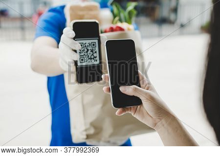Woman Customer Using Digital Mobile Phone Scan Qr Code Paying For Buying Fresh Food Set Bag From Foo