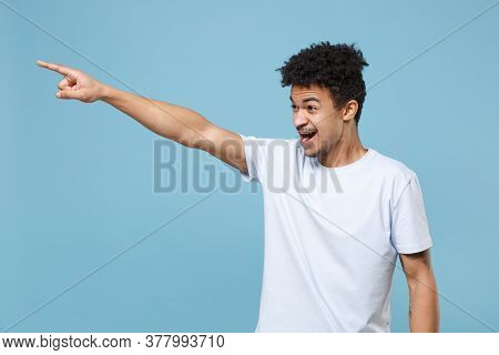 Irritated Young African American Guy In Casual White T-shirt Posing Isolated On Blue Background Stud