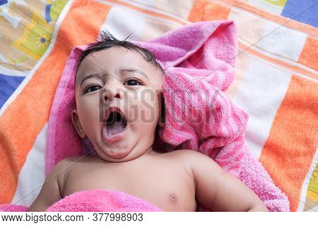 An Infant Toddler Baby Boy Wet With Foam Enjoying Shower Bathing Rubbed By Towel