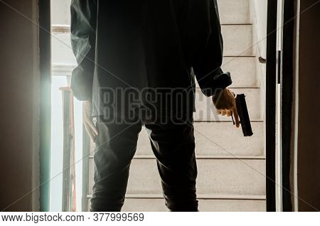 Killer With Gun Close Up Over Stair Background