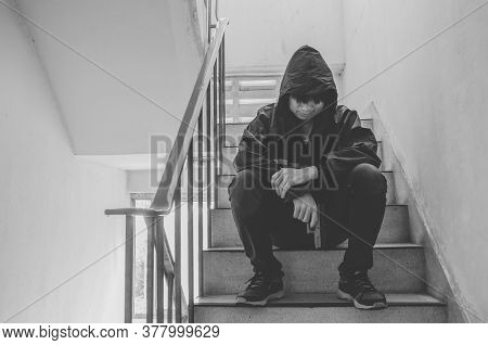 Gangster Sitting On Stairs, Alone With His Thoughts And His Guns